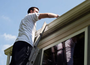 inspecting roof for damage