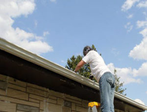 cleaning gutter for roof maintenance