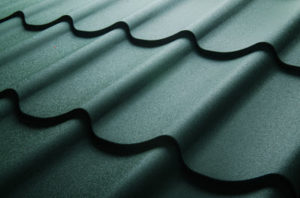 replacing old roof with green metal shingles