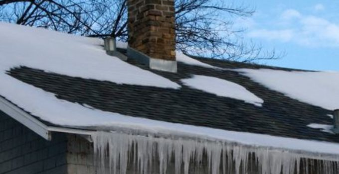 heavily iced roof in winter