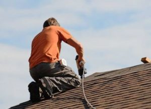 replacing an asphalt roof that sustained storm damage